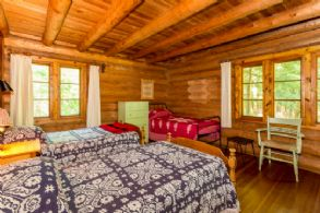 Main Lodge Bedroom - Country homes for sale and luxury real estate including horse farms and property in the Caledon and King City areas near Toronto