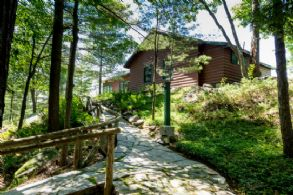 Approach to Hideaway Guest Cottage - Country homes for sale and luxury real estate including horse farms and property in the Caledon and King City areas near Toronto