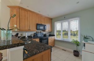 Apartment Kitchen - Country homes for sale and luxury real estate including horse farms and property in the Caledon and King City areas near Toronto