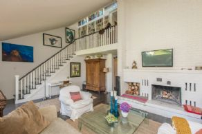 Family Room with 2-storey Fireplace - Country homes for sale and luxury real estate including horse farms and property in the Caledon and King City areas near Toronto