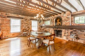 Dining Room with Fireplace - Country homes for sale and luxury real estate including horse farms and property in the Caledon and King City areas near Toronto