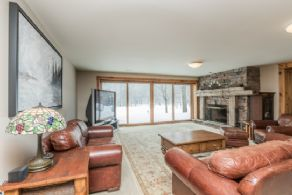 Family Room with Stone Fireplace - Country homes for sale and luxury real estate including horse farms and property in the Caledon and King City areas near Toronto