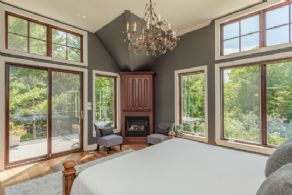 Master bedroom with amazing views and fireplace - Country homes for sale and luxury real estate including horse farms and property in the Caledon and King City areas near Toronto
