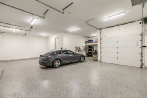 4-car Garage with Tesla Charging Station - Country homes for sale and luxury real estate including horse farms and property in the Caledon and King City areas near Toronto