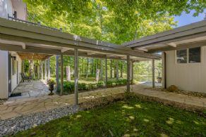 Covered stone walkway joining the guest house & main house - Country homes for sale and luxury real estate including horse farms and property in the Caledon and King City areas near Toronto